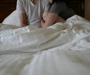 couple and bed image