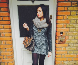 black tights, boots, and heels image