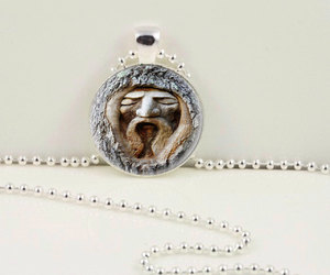 face pendant, tree necklace, and tree pendant image