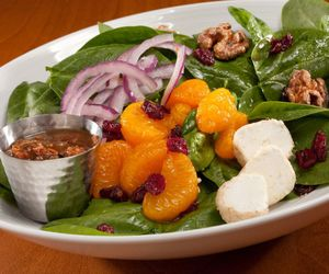 spinach salad, with mandarin oranges, and and candied walnuts image