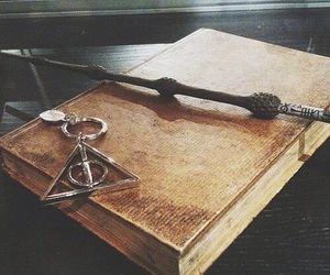 albus dumbledore, deathly hallows, and golden snitch image