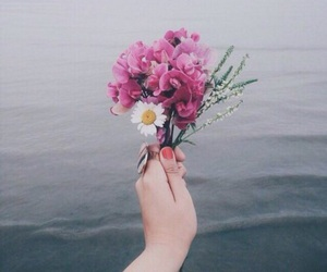 flowers, sea, and hand image