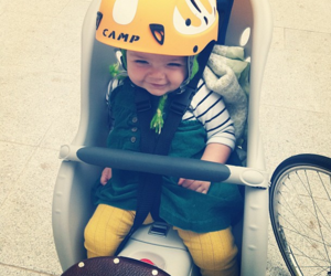 Bike ride, smiley baby girl, and little e image