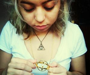 deathly hallows, harry potter, and timeturner image