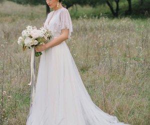 bolero, tulle wedding dress, and Flowy image