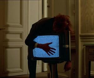 tv, dark, and hand image
