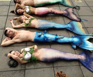 mermaids, sun, and ocean image