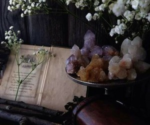flowers, book, and crystal image