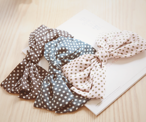 bow, girly, and polka dots image