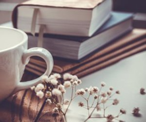 book, cup, and flowers image