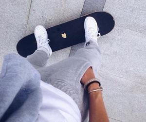 boy, girl, and skateboard image
