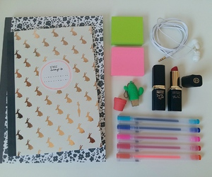 headphones, notebooks, and post it notes image