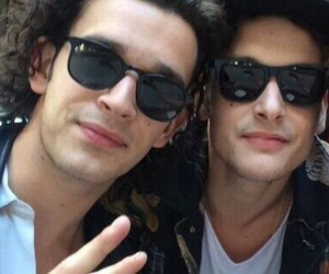 the 1975, george daniel, and matty healy image