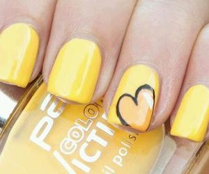 nails and yellow image