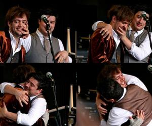 hug, marcus mumford, and ben lovett image