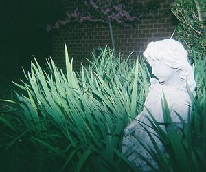 green, dark, and statue image