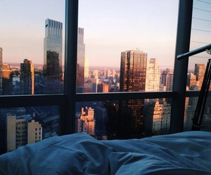 bed, sun, and city image