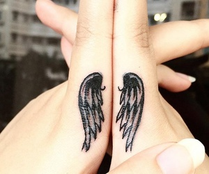 hand, tattoo, and wing image