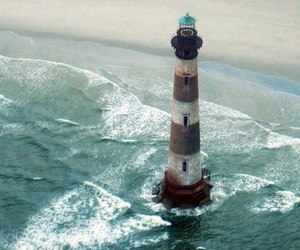 sea, lighthouse, and waves image