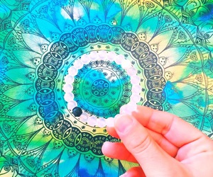 blue, green, and mandala image