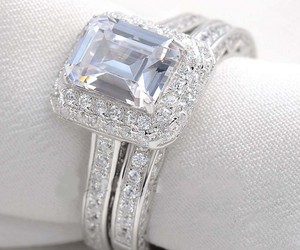 silver, white, and engagment ring image