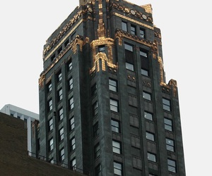 gold, black, and building image