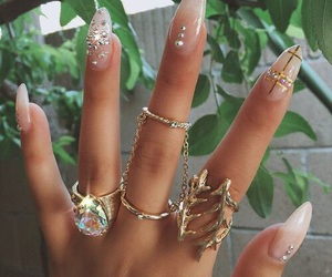 diamond ring, fingernails, and gold ring image