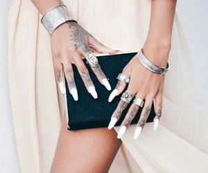 finger tattoos, silver bracelet, and silver rings image