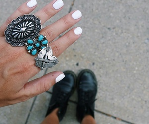 white nails, silver rings, and black dr martens image