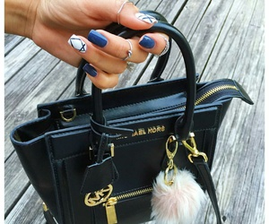 silver rings, black leather purse, and navy blue nails image