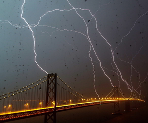 bridge, lightning, and rain image