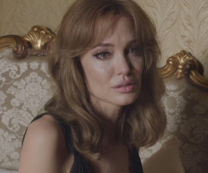 Angelina Jolie, by the sea, and movie image