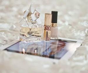 daisy, perfume, and ipad image