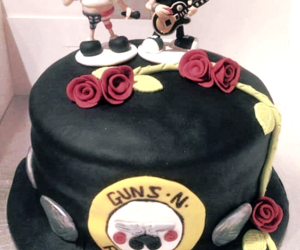 axl rose, flowers, and guns image