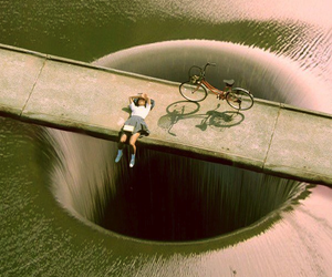 bike, water, and hole image
