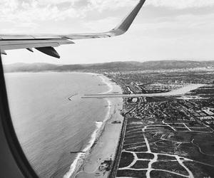 city, airplane, and sea image