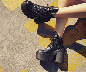black boots, chunky heels, and lace-up image