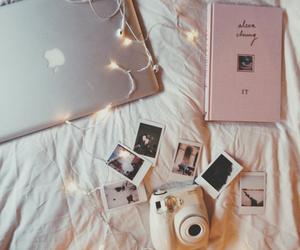 book, light, and polaroid image