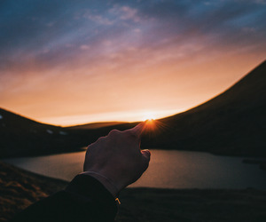 mountains, hand, and sunset image