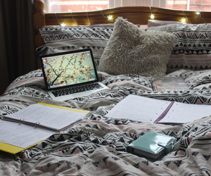 study, bed, and laptop image
