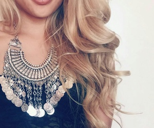brown lipstick, silver necklaces, and black lace bustier image