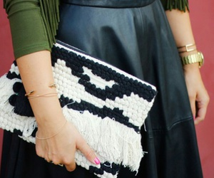 gold bracelet, gold watch, and black leather skirts image