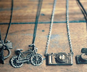 necklace, camera, and bike image