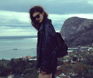 black jacket, landscape, and legs image