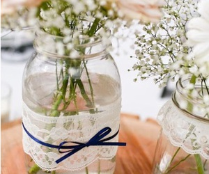center piece, flowers, and lace image