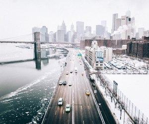buildings, frozen lake, and cars image