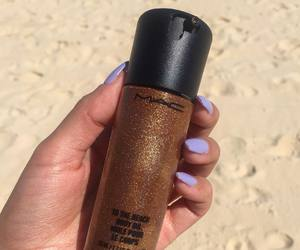 mac, body oil, and shimmering gold image