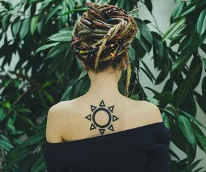 tattoo, sun, and dreads image