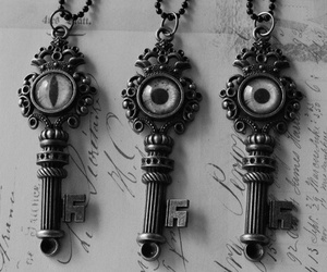 key, black and white, and eyes image