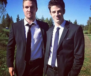 arrow, grant gustin, and stephen amell image
